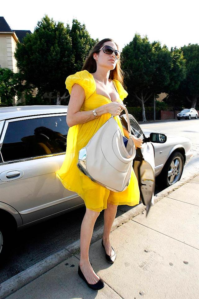 "A pregnant Angelina Jolie stepped out in a eye-catching yellow dress on Thursday. Even a giant handbag couldn't obscure Angelina's changing figure. RL-MBF/<a href=""http://www.x17online.com"" target=""new"">X17 Online</a> - April 24, 2008"
