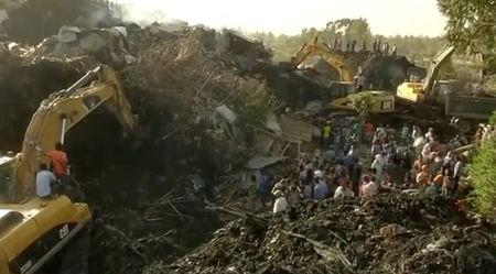 Excavators work after a landslide at a garbage dump on the outskirts of Addis Ababa, Ethiopia in this still image taken from a video from March 12, 2017. REUTERS/Reuters TV