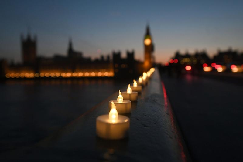 Candle lights on Westminster Bridge - PA Wire/PA Images