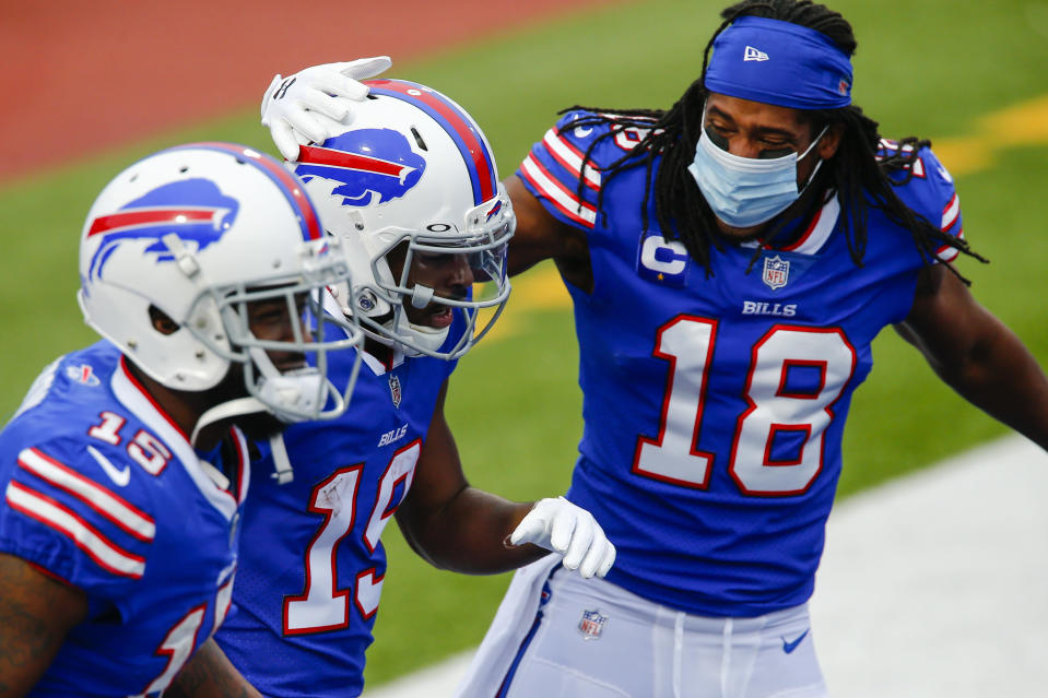 Buffalo Bills wide receiver Isaiah McKenzie (19) celebrates with teammates after running in for a touchdown in the first half of an NFL football game against the Miami Dolphins, Sunday, Jan. 3, 2021, in Orchard Park, N.Y. (AP Photo/John Munson)
