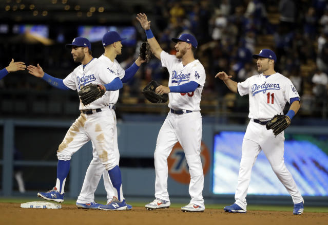 The Los Angeles Dodgers celebrate after a 6-5 win over the San Francisco Giants during a baseball game, Tuesday, April 2, 2019, in Los Angeles. (AP Photo/Marcio Jose Sanchez)
