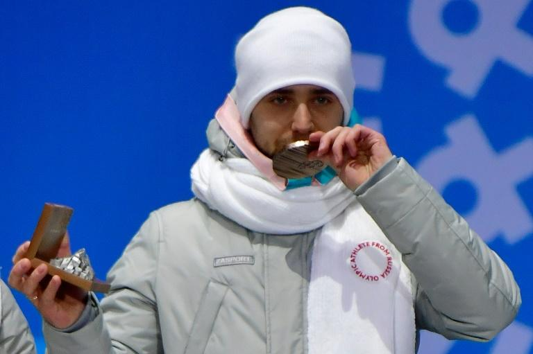 Russia's bronze medallist Alexander Krushelnitsky is banned from the Olympics and must return his medal in the mixed curling event, the Court of Arbitration for Sport announced Thursday