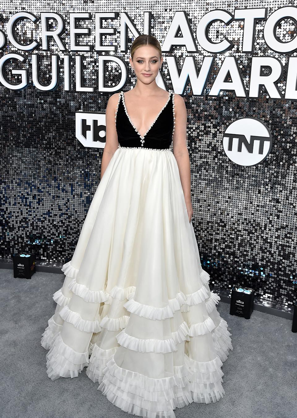 """The """"Hustlers"""" star's black and white Miu Miu gown was a red carpet win on the silver carpet."""