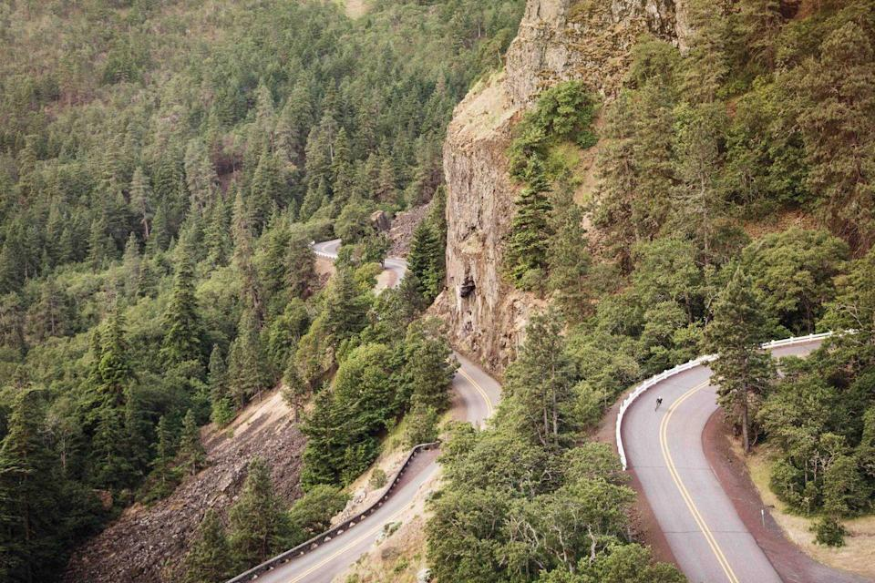 """<p><strong>The Drive: </strong><a href=""""https://www.tripadvisor.com/Attraction_Review-g52104-d116788-Reviews-Columbia_River_Highway-Troutdale_Oregon.html"""" rel=""""nofollow noopener"""" target=""""_blank"""" data-ylk=""""slk:Historic Columbia River Highway"""" class=""""link rapid-noclick-resp"""">Historic Columbia River Highway</a></p><p><strong>The Scene: </strong>Known as America's first scenic highway, the Historic Columbia River Highway runs a total length of 73 miles through the <a href=""""https://www.tripadvisor.com/Attraction_Review-g28958-d116954-Reviews-Columbia_River_Gorge_National_Scenic_Area-Oregon.html"""" rel=""""nofollow noopener"""" target=""""_blank"""" data-ylk=""""slk:Columbia River Gorge National Scenic Area"""" class=""""link rapid-noclick-resp"""">Columbia River Gorge National Scenic Area</a> from <a href=""""https://www.tripadvisor.com/Attractions-g52104-Activities-Troutdale_Oregon.html"""" rel=""""nofollow noopener"""" target=""""_blank"""" data-ylk=""""slk:Troutdale"""" class=""""link rapid-noclick-resp"""">Troutdale</a> to the <a href=""""https://www.tripadvisor.com/Tourism-g52093-The_Dalles_Oregon-Vacations.html"""" rel=""""nofollow noopener"""" target=""""_blank"""" data-ylk=""""slk:Dalles"""" class=""""link rapid-noclick-resp"""">Dalles</a>. </p><p><strong>The Pit-Stop: </strong>Get the best views of the Gorge from the <a href=""""https://www.tripadvisor.com/Attraction_Review-g51815-d102493-Reviews-Vista_House-Corbett_Oregon.html"""" rel=""""nofollow noopener"""" target=""""_blank"""" data-ylk=""""slk:Vista House"""" class=""""link rapid-noclick-resp"""">Vista House</a> at Crown Point. </p>"""