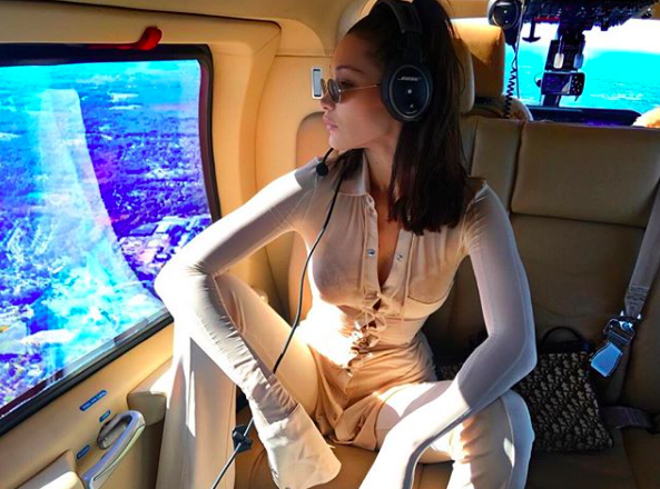 <p>The model gets her manspread on on a plane [Photo: Instagram/bellahadid] </p>