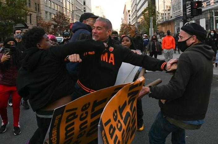 A supporter of US President Donald Trump is attacked by counter-protesters on Black Lives Matter Plaza in Washington, DC on November 14, 2020
