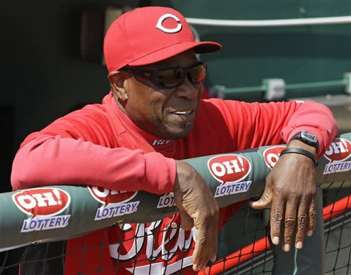 Cincinnati Reds manager Dusty Baker watches from the dugout rail prior to the start of a baseball game against the Washington Nationals, Saturday, April 6, 2013, in Cincinnati. (AP Photo/Al Behrman)