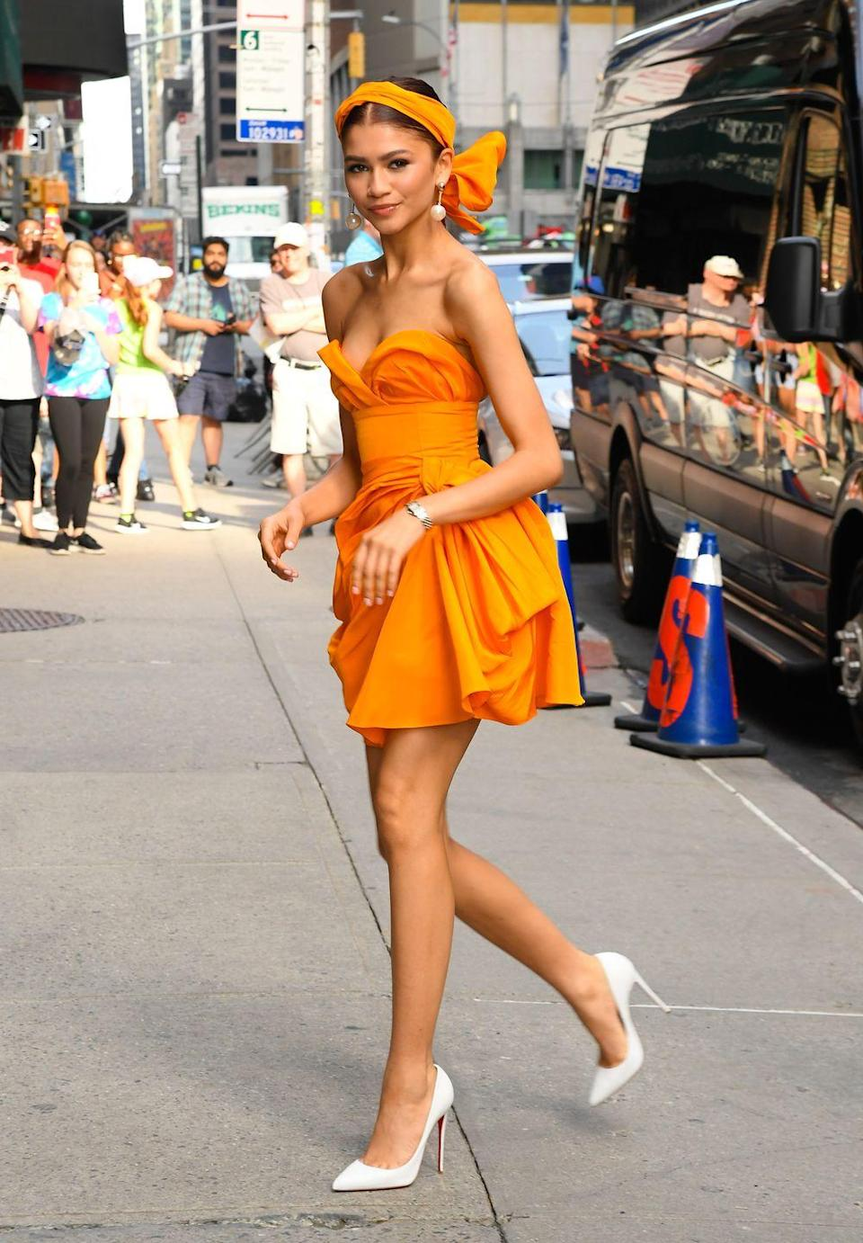 <p>For an appearance on <em>T</em><em>he Late Show With Stephen Colbert</em>, she wore this bright mini dress by Carolina Herrera. Her matching hairpiece and white Louboutin pumps made this a fun ensemble for the summertime. </p>