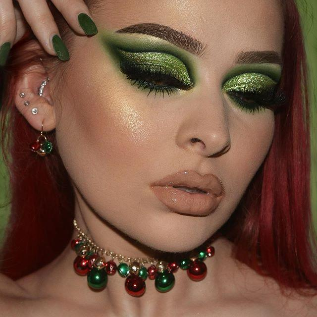 """<p>Green shimmer shadow in a cat-eye shape makes for a dramatic look. The red and green beaded choker and dangle earrings, as well as green polish on the nails, keep the color palette simple and traditional.</p><p><a class=""""link rapid-noclick-resp"""" href=""""https://www.amazon.com/Black-Radiance-Appeal-Shadow-Palette/dp/B0845BNVKJ/?tag=syn-yahoo-20&ascsubtag=%5Bartid%7C10050.g.34534998%5Bsrc%7Cyahoo-us"""" rel=""""nofollow noopener"""" target=""""_blank"""" data-ylk=""""slk:SHOP GREEN SHIMMER EYESHADOW PALETTE"""">SHOP GREEN SHIMMER EYESHADOW PALETTE</a></p><p><a href=""""https://www.instagram.com/p/B6e5RFoJZcv/?utm_source=ig_embed&utm_campaign=loading"""" rel=""""nofollow noopener"""" target=""""_blank"""" data-ylk=""""slk:See the original post on Instagram"""" class=""""link rapid-noclick-resp"""">See the original post on Instagram</a></p>"""