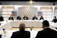 U.S. Secretary of State Mike Pompeo, center, attends a meeting with the Federation of Northern Greek Industries in the northern city of Thessaloniki, Greece, Monday, Sept. 28, 2020. Tension in the eastern Mediterranean is to feature prominently during Pompeo's two-day stay in Greece, which will include a visit to the Souda Bay naval base on the southern island of Crete Tuesday. (AP Photo/Giannis Papanikos, Pool)