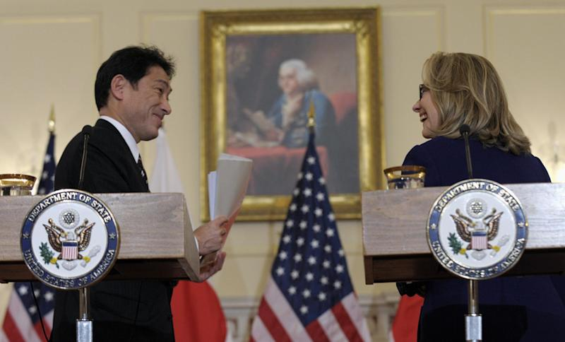 Secretary of State Hillary Rodham Clinton and Japanese Foreign Minister Fumio Kishida talk as they finish their joint press availability at the State Department in Washington, Friday, Jan. 18, 2013. (AP Photo/Susan Walsh)