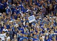 Oct 5, 2014; Kansas City, MO, USA; Kansas City Royals fans hold up a sign against the Los Angeles Angels during game three of the 2014 ALDS baseball playoff game at Kauffman Stadium. Mandatory Credit: Peter G. Aiken-USA TODAY Sports