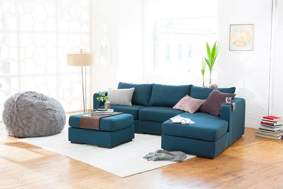 """<p>From its <a href=""""https://www.marthastewart.com/1145892/surprising-items-you-can-clean-washing-machine"""">machine-washable</a> covers to its reconfigurable design, the <a href=""""https://www.lovesac.com/"""">Lovesac</a> Sactional is built to last. When you order the couch, the pieces&mdash;which are made from discarded water bottles and recycled foam&mdash;are vacuum-compressed and delivered in recycled cardboard to reduce carbon emissions.</p>"""