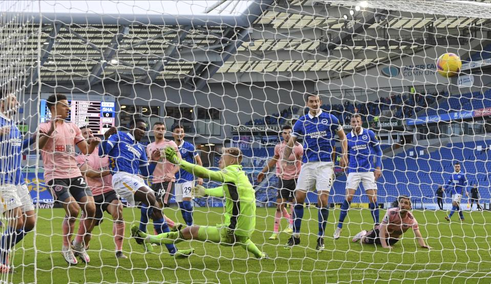 Brighton and Hove Albion's Danny Welbeck scores his side's first goal during the English Premier League soccer match between Brighton and Hove Albion and Sheffield United at the American Express Community Stadium in Brighton, England, Saturday, Dec. 20, 2020. (Mike Hewitt/Pool via AP)