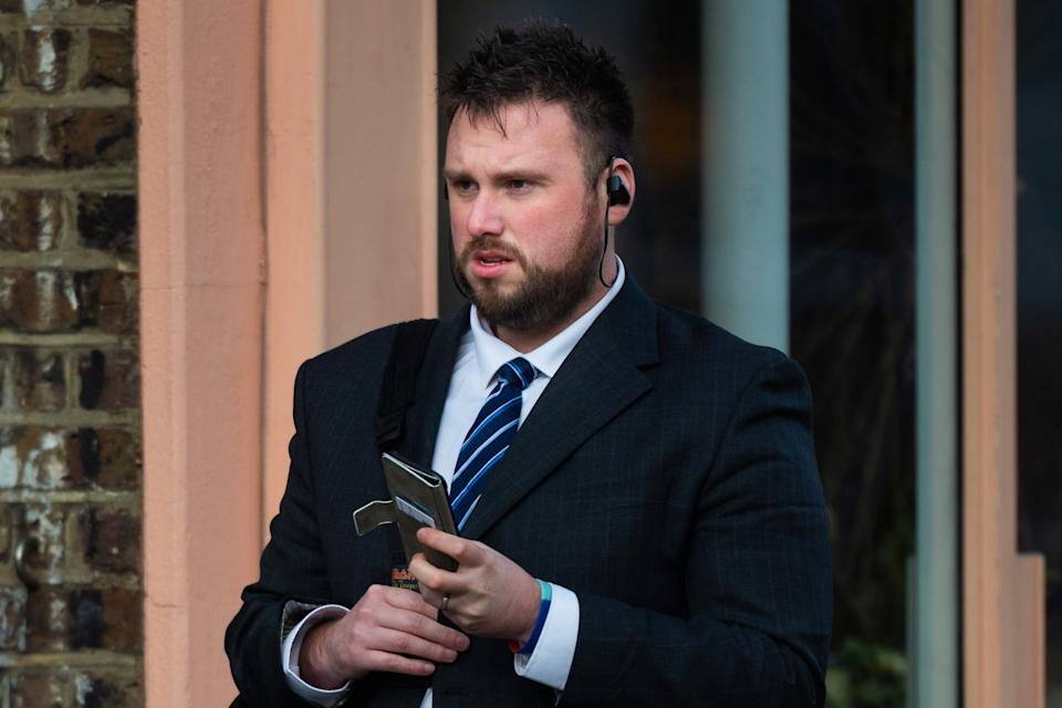 PC Andrew Brooks arrives at a disciplinary hearing at the Met Police headquarters in London. (SWNS)
