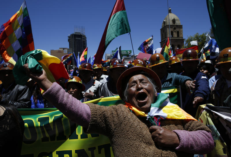 A female supporter of Bolivian President Evo Morales shows her support during a march in La Paz, Bolivia, Wednesday, Oct. 23, 2019. Morales said Wednesday his opponents are trying to stage a coup against him as protests grow over a disputed election he claims he won outright, though a nearly finished vote count suggests it might head to a second round. (AP Photo/Juan Karita)