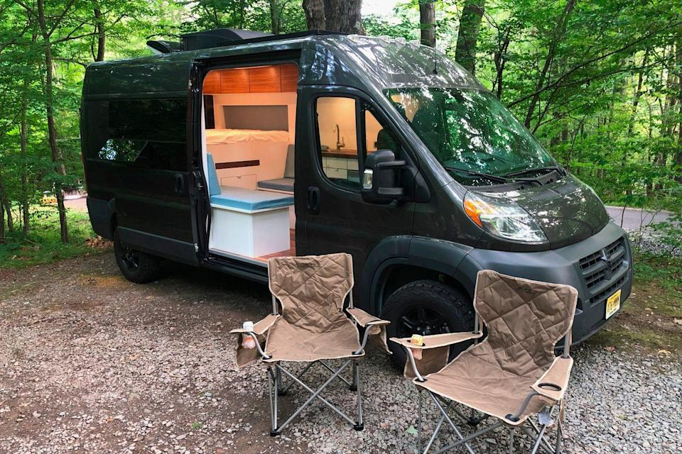 """<p>To see what it's actually like to escape the madness of the rat race and the real world in a camper van, we borrowed one of Ready.Set.Van's rigs — a brown model equipped with a large bed, a refrigerator, induction stovetop, pop-out table and outdoor shower, which retails for around $80,000 — for a serene weekend of camping.</p><p><a class=""""link rapid-noclick-resp"""" href=""""https://www.gearpatrol.com/cars/a33985326/ready-set-van-camper-van-review/"""" rel=""""nofollow noopener"""" target=""""_blank"""" data-ylk=""""slk:LEARN MORE"""">LEARN MORE</a></p>"""
