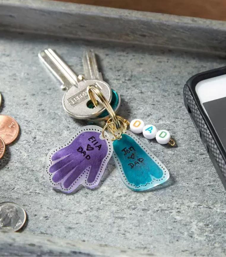 """<p>It's a handprint craft — but shrunk down so Dad can keep it with him always. If you make it a yearly tradition, you can have fun comparing how much they've grown.</p><p><a href=""""https://www.joann.com/fathers-day-key-ring-keep-sake/18810882P93.html"""" rel=""""nofollow noopener"""" target=""""_blank"""" data-ylk=""""slk:Get the tutorial at JOANN »"""" class=""""link rapid-noclick-resp""""><em>Get the tutorial at JOANN »</em></a></p>"""