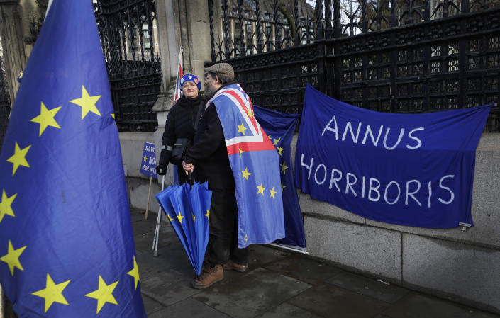 "Anti Brexit pro-Europe campaigners demonstrate outside Parliament with the Latin phrase ""horrible year"" on the banner, in London, Wednesday, Jan. 15, 2020. Britain is due to leave the European Union on Jan. 31. (AP Photo/Kirsty Wigglesworth)"