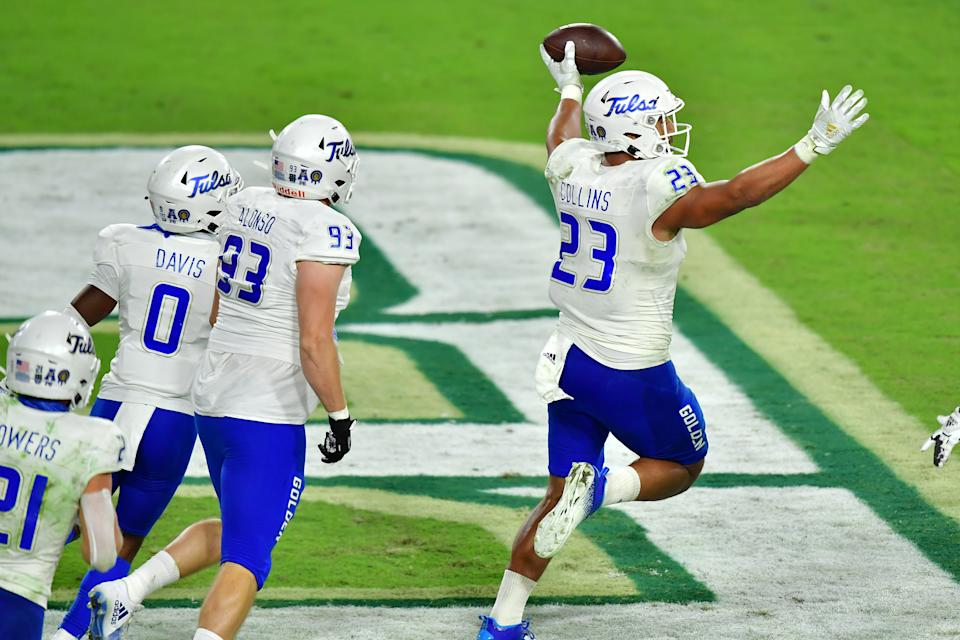 TAMPA, FLORIDA - OCTOBER 23: Zaven Collins #23 of the Tulsa Golden Hurricane celebrates after intercepting a pass thrown by Noah Johnson #0 of the South Florida Bulls and scoring during the second half at Raymond James Stadium on October 23, 2020 in Tampa, Florida. (Photo by Julio Aguilar/Getty Images)