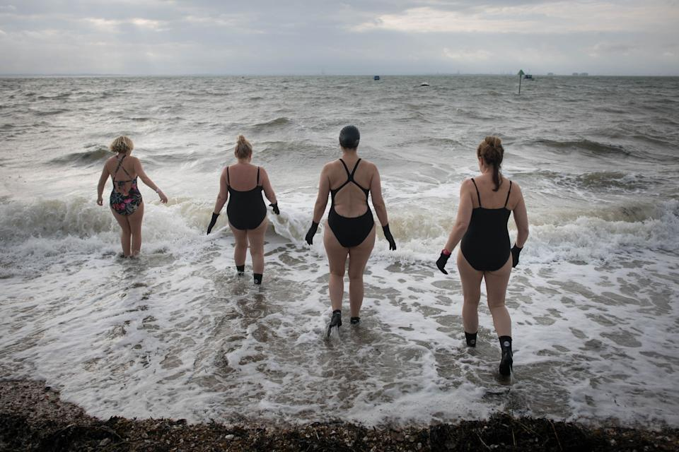 Swimmers prepare for dip in the Thames estuary at Chalkwell Beach near Southend On Sea in Essex. (PA)