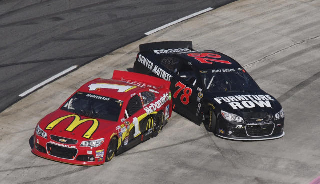 Sprint Cup Series driver Jamie McMurray (1) and Kurt Busch (78) spin out during the NASCAR Sprint Cup auto race at Martinsville Speedway in Martinsville, Va., Sunday, Oct. 27, 2013. (AP Photo/Steve Sheppard)