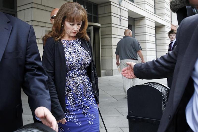 Eileen McNamee, the estranged wife of Brian McNamee, the former trainer for former Major League Baseball pitcher Roger Clemens, leaves federal court in Washington, Wednesday, June 6, 2012,, after testifying in Clemens' perjury trial.  (AP Photo/Jacquelyn Martin)