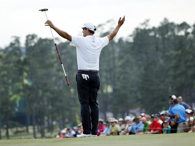 Defending Masters champion Adam Scott, of Australia, acknowledges applause on the 18th green following his fourth round of the Masters golf tournament Sunday, April 13, 2014, in Augusta, Ga. (AP Photo/Matt Slocum)