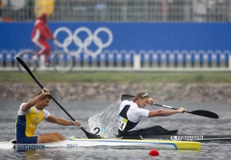 Gustafsson of Sweden competes with Ferguson of New Zealand during the men's kayak single (K1) 500m semi-final at the Beijing 2008 Olympic Games