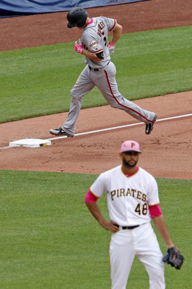 San Francisco Giants' Nick Hundley, top, rounds third after hitting a three-run home run off Pittsburgh Pirates relief pitcher Richard Rodriguez (48) in the sixth inning of a baseball game in Pittsburgh, Sunday, May 13, 2018. (AP Photo/Gene J. Puskar)