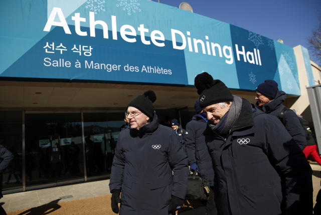 <p>International Olympic Committee President Thomas Bach, left, tours the PyeongChang Olympic Village with IOC officials prior to the 2018 Winter Olympics in PyeongChang, South Korea. (Patrick Semansky/AP) </p>