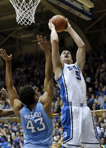 Duke's Mason Plumlee (5) shoots over North Carolina's James Michael McAdoo (43) during the first half of an NCAA college basketball game in Durham, N.C., Wednesday, Feb. 13, 2013. (AP Photo/Gerry Broome)