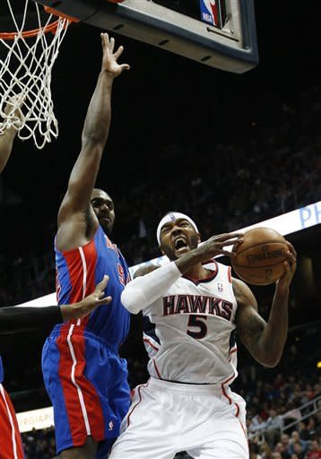 Atlanta Hawks small forward Josh Smith (5) goes to the basket as Detroit Pistons power forward Jason Maxiell (54) drefends in the first half of an NBA basketball game on Wednesday, Dec. 26, 2012, in Atlanta. (AP Photo/John Bazemore)