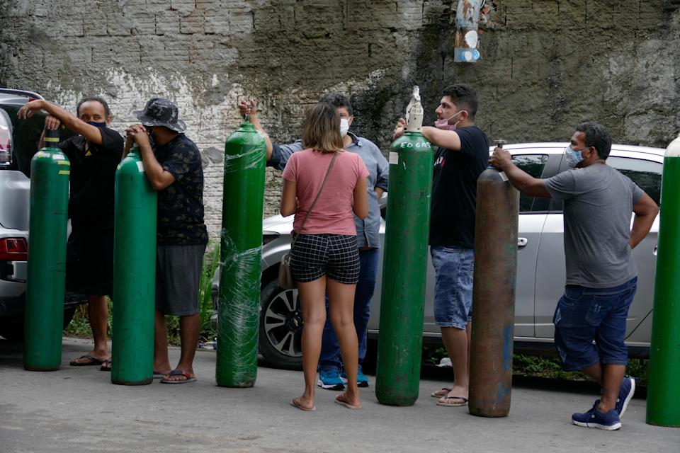 MANAUS , Jan. 15, 2021 -- People queue up to buy oxygen at an oxygen factory in Manaus of Amazonas, Brazil, Jan. 15, 2021. Brazil's northern state of Amazonas moved to send 235 patients hospitalized for COVID-19 to other states as its healthcare system was stretched to the limit, Governor Wilson Lima said Thursday.    Hospitals in state capital Manaus are crowded and lack the oxygen needed to treat infected patients, he said. (Photo by Sandro Pereira/Xinhua via Getty) (Xinhua/Sandro Pereira via Getty Images)