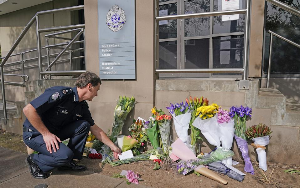 Victoria Police Deputy Commissioner Shane Patton lays a tribute at Boroondara Police Station near the Chandler Highway. Source: AAP