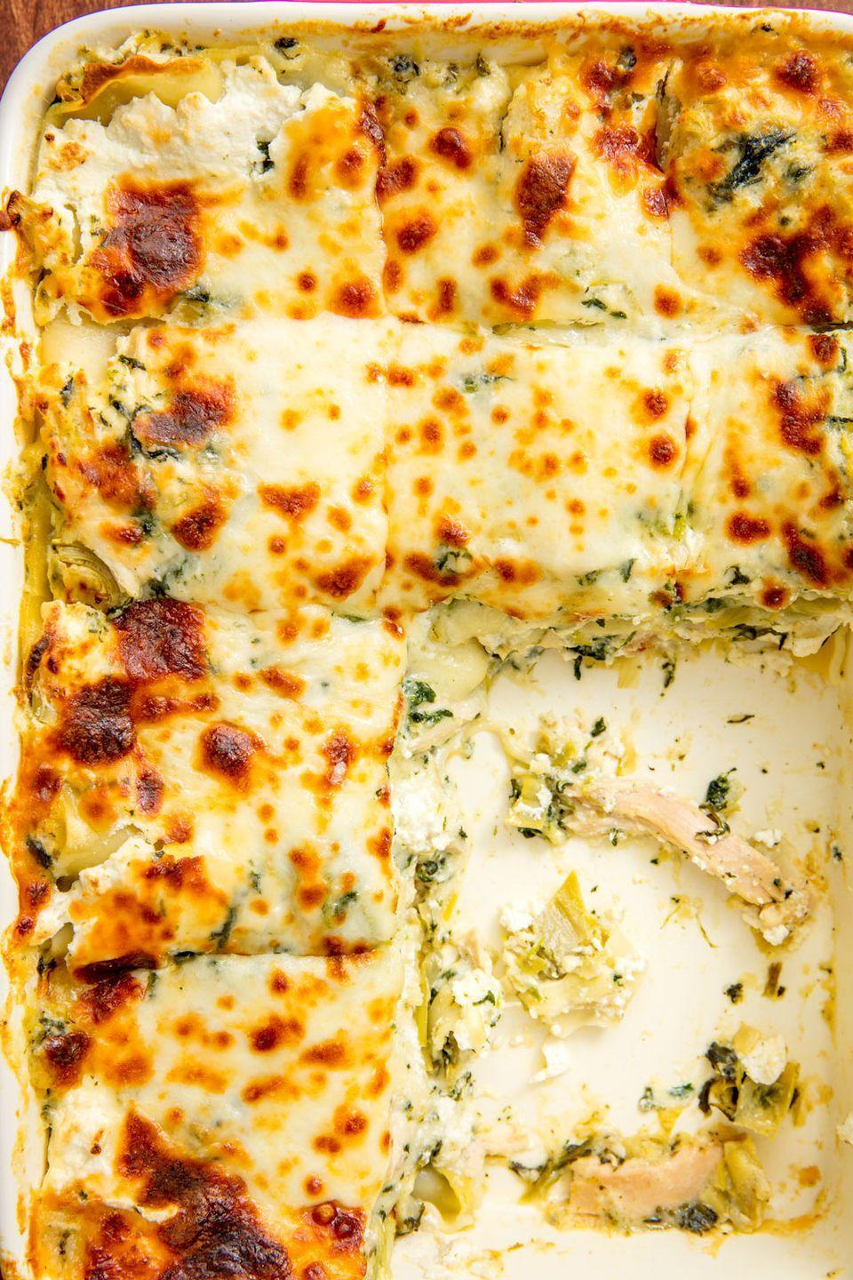 """<p>This thing is RICH.</p><p>Get the recipe from <a href=""""https://www.delish.com/cooking/recipe-ideas/recipes/a45592/cheesy-spinach-and-artichoke-lasagna-recipe/"""" rel=""""nofollow noopener"""" target=""""_blank"""" data-ylk=""""slk:Delish"""" class=""""link rapid-noclick-resp"""">Delish</a>. </p>"""