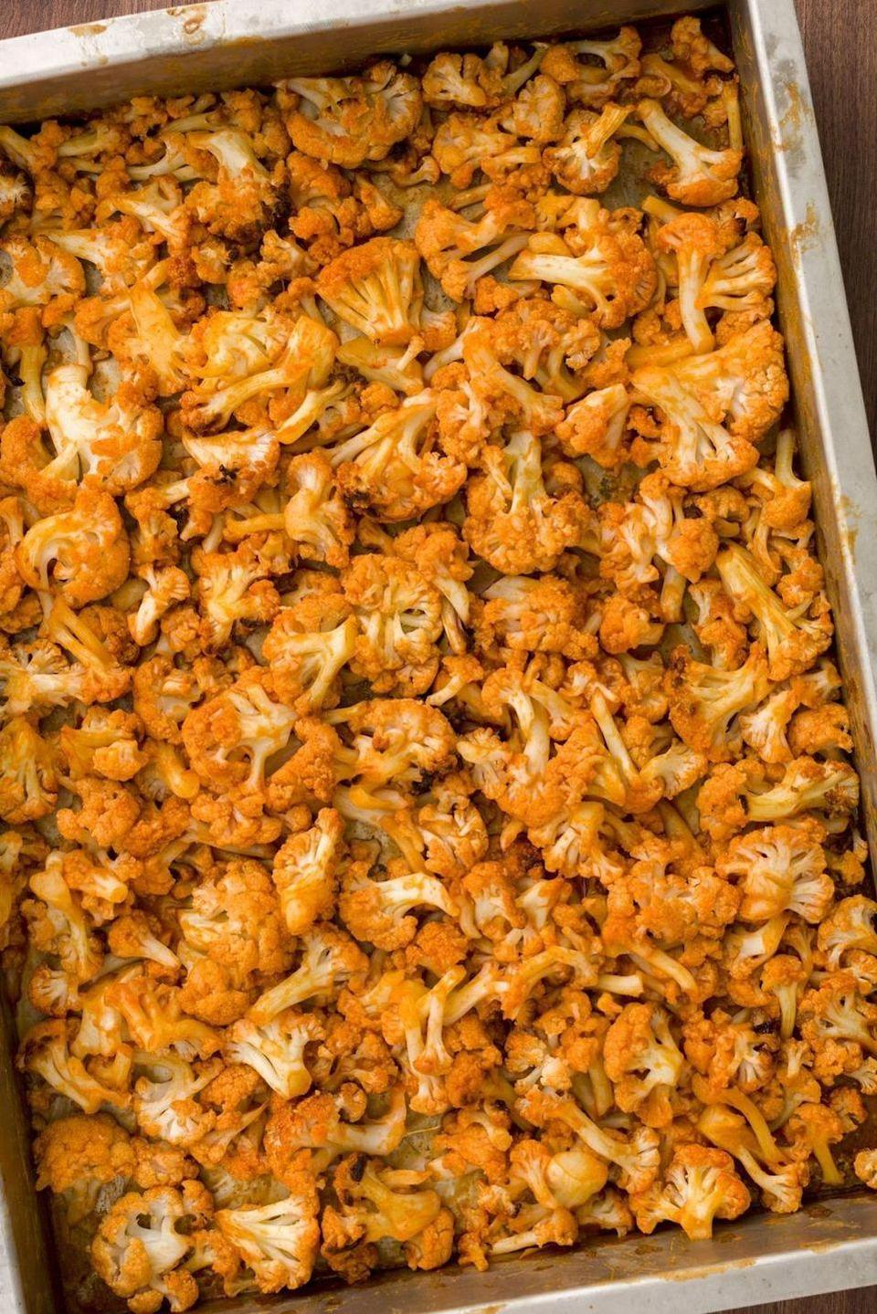 """<p>Sure, <a href=""""https://www.delish.com/uk/cooking/recipes/a29571609/classic-buffalo-wings-recipe/"""" rel=""""nofollow noopener"""" target=""""_blank"""" data-ylk=""""slk:buffalo wings"""" class=""""link rapid-noclick-resp"""">buffalo wings</a> are great, but they're not for everyone. These roasted cauliflower bites are much lighter, vegetarian, and like, actually good for you. For a sweet/savoury twist, add 2 teaspoons of honey to the butter and hot sauce mixture!</p><p>Get the <a href=""""https://www.delish.com/uk/cooking/recipes/a29866994/buffalo-cauliflower-recipe/"""" rel=""""nofollow noopener"""" target=""""_blank"""" data-ylk=""""slk:Buffalo Cauliflower"""" class=""""link rapid-noclick-resp"""">Buffalo Cauliflower</a> recipe.</p>"""