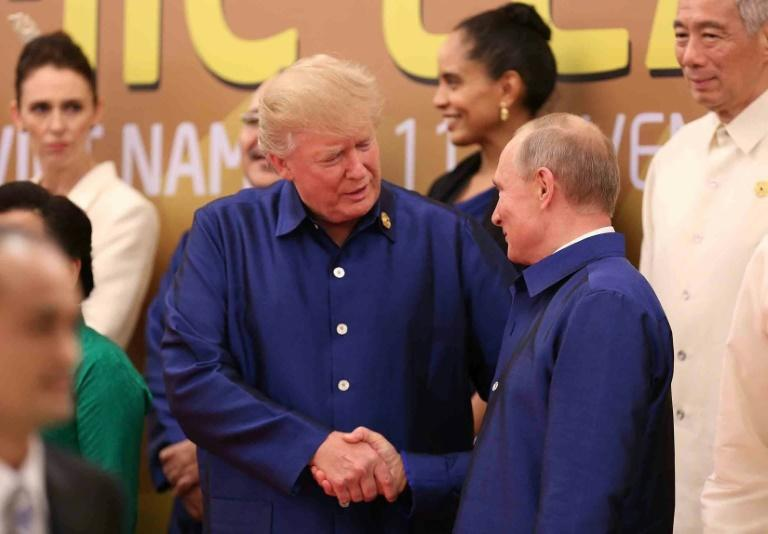 """He (Putin) said he didn't meddle. I asked him again,"" US President Donald Trump told reporters on Air Force One as he flew to Hanoi for a state visit"