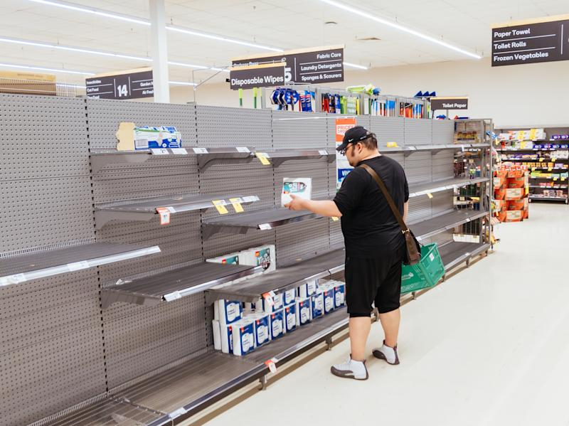 A man looks for toilet paper in an Australian supermarket in March this year, after panic buying due to coronavirus. Source: Getty Images