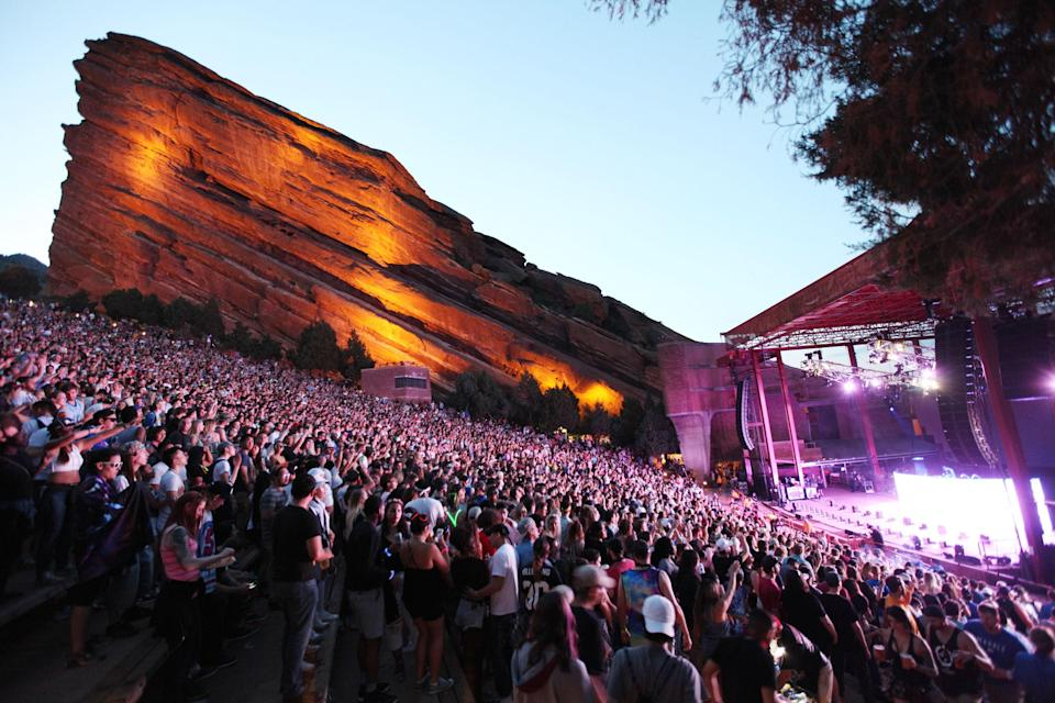 "<p><strong>Give us the big picture: What's this place like?</strong><br> There's a reason Red Rocks is considered one of the most beautiful music venues in the country. Bright red sandstone rocks jut out from either side of the stage to create a natural amphitheater, and concert goers are treated to views of downtown Denver and the surrounding foothills. Start with tailgating in the dusty parking lots, then head up the stairs—oh so many stairs—for pitch-perfect music under the stars. This is Colorado at its best: casual, authentic, and outdoorsy.</p> <p><strong>Run us through the calendar of events.</strong><br> The Red Rocks concert calendar kicks off in early spring and runs through late fall, featuring everything from country music to the Colorado Symphony. The venue's eclectic lineup is also accompanied by ""Film on the Rocks,"" weekly screenings of popular movies that begin at dusk.</p> <p><strong>How are the seats?</strong><br> A steep pitch and impressive views mean that there's hardly a bad seat at Red Rocks, although windy nights can diminish the sound quality up top. Large TV screens and clear sightlines make the stage visible to all, and it's easy to stash bags and coats under the long rows of bench seats. Space gets tight in the general admission sections as people jockey for a spot, but none of that matters once everyone stands up to dance. Come dressed for the weather; shows are held rain or shine.</p> <p><strong>Can we bring the whole family?</strong><br> Locals know that it's a rite of passage to bring kids to Red Rocks, so you'll often see babies in headphones and young kids dancing at age-appropriate shows. Traffic leaving the venue can take up to an hour to subside, though, so if the little ones join you, it's best to leave before the last song.</p> <p><strong>What</strong> <em><strong>really</strong></em> <strong>makes this place stand out?</strong><br> The acclaimed acoustics of Red Rocks—to say nothing of the scenery—makes it a bucket list venue for many artists and many music fans. Big-time musicians often choose Red Rocks to film their next video, record a live album, or debut a new song.</p> <p><strong>Any final notes?</strong><br> Summer in Denver isn't complete without at least a trip or two up to Red Rocks, and the event calendar offers something for everyone. Get tickets to celebrate a birthday or just because it's Tuesday; an evening singing under the stars is a Colorado night done right.</p>"