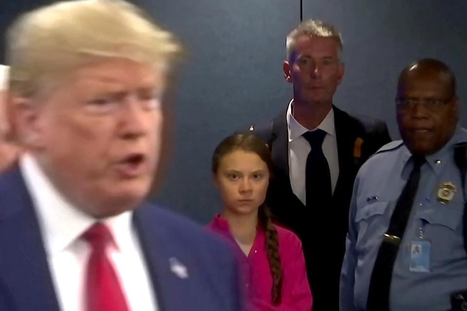 Swedish environmental activist Greta Thunberg watches US president Donald Trump enter the United Nations on Monday (Picture: Reuters)