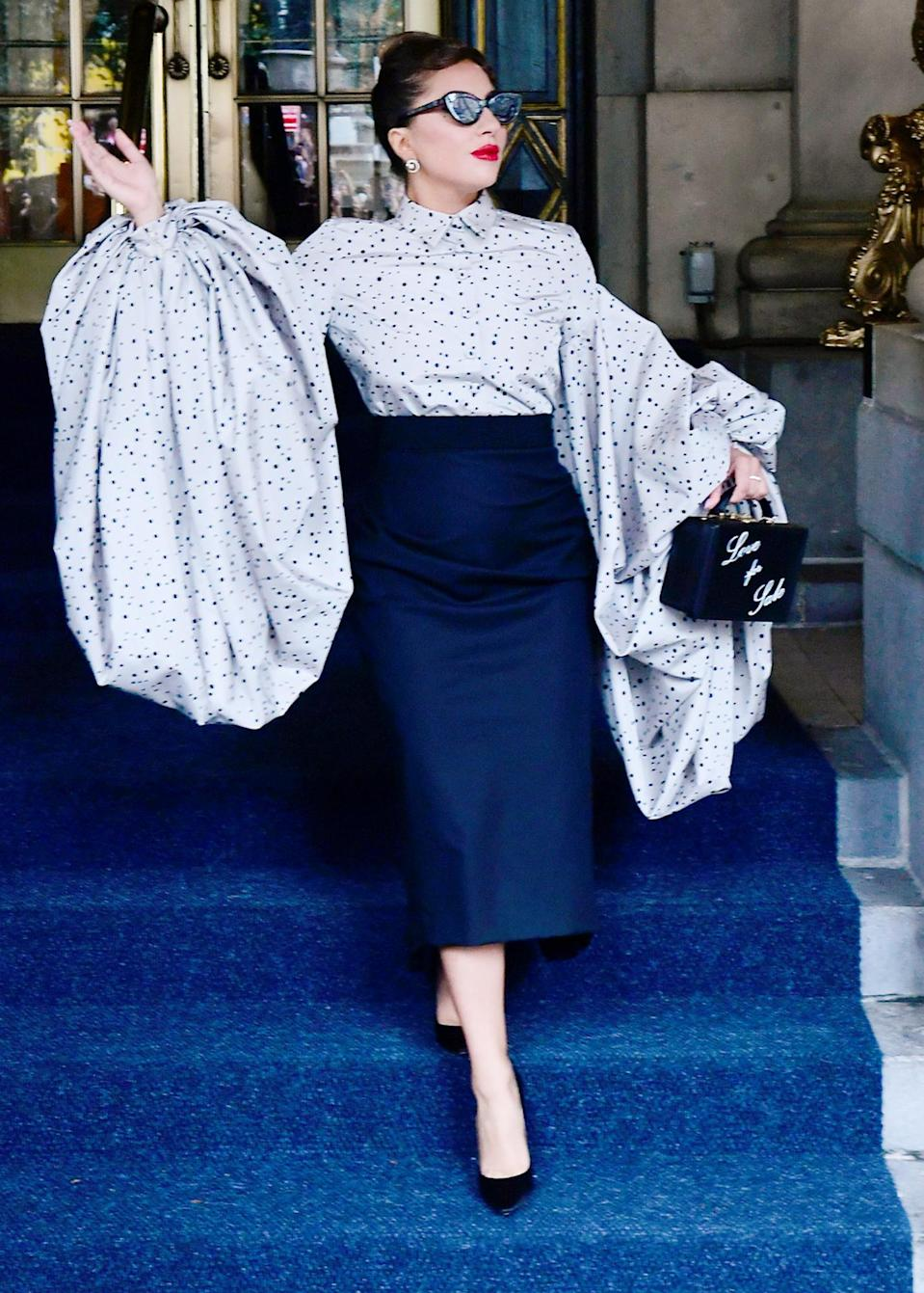 <p>Lady Gaga takes glam to the next level with her patterned blouse with oversized sleeves on July 2 in N.Y.C.</p>
