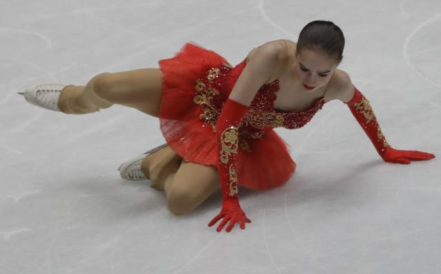Alina Zagitova of Russia falls during the women's free skating program, at the Figure Skating World Championships in Assago, near Milan, Italy, Friday, March 23, 2018. (AP Photo/Luca Bruno)