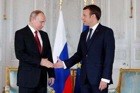 French President Macron meets Russian President Putin