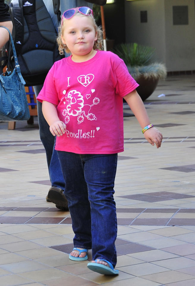 "The seven-year-old Southern beauty pageant contestant Alana ""Honey Boo Boo"" Thompson walks to a West Hollywood meeting accompanied by her mother June Shannon and a bodyguard.