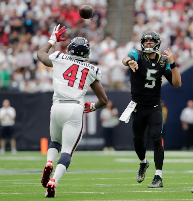 <p>Blake Bortles #5 of the Jacksonville Jaguars thows a pass in the first quarter defended by Zach Cunningham #41 of the Houston Texans at NRG Stadium on September 10, 2017 in Houston, Texas. (Photo by Tim Warner/Getty Images) </p>