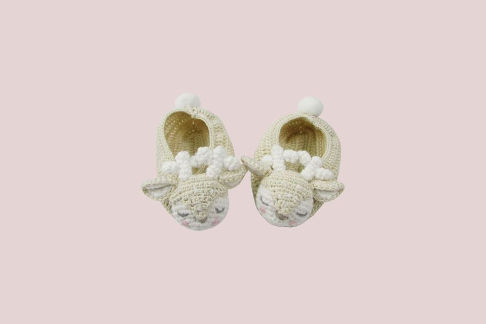 """<p>These hand-crocheted booties are the precious gift. Sweet details—doe-eyed and rosy-cheeked—make this pair whimsical, comfy, and cute as can be.</p> <p><strong><em>Shop Now: </em></strong><em>Albetta Crochet Deer Booties, $28, <a href=""""https://click.linksynergy.com/deeplink?id=93xLBvPhAeE&mid=42688&murl=https%3A%2F%2Fwww.maisonette.com%2Fproduct%2Fcrochet-deer-booties&u1=MSL25GiftsforaBabyShowerinaBoxDeliveryPackagerhaarsBabGal7845171202007I"""" rel=""""nofollow noopener"""" target=""""_blank"""" data-ylk=""""slk:maisonette.com"""" class=""""link rapid-noclick-resp"""">maisonette.com</a></em><em>.</em></p>"""