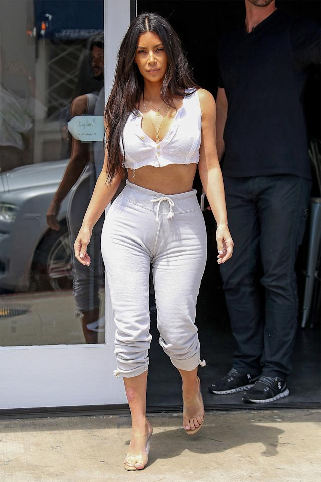 <p>In a white plunging crop top, gray drawstring sweatpants and Yeezy heels out in Sherman Oaks, California.  </p>
