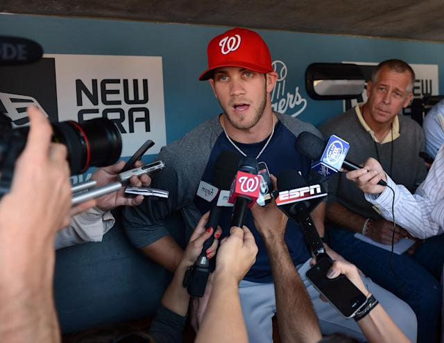 LOS ANGELES, CA - APRIL 28: Bryce Harper #34 of the Washington Nationals speaks to the media in his major league debut during practice before the game against the Los Angeles Dodgers at Dodger Stadium on April 28, 2012 in Los Angeles, California. (Photo by Harry How/Getty Images)