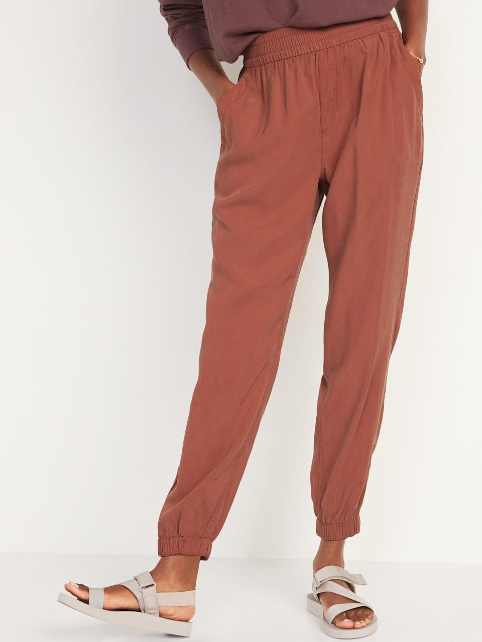 <p>Woven <span>Old Navy High-Waisted Twill Jogger Pants</span> ($35) make a good baby step between sweats and pants, and this ruddy color really pops this month.</p>